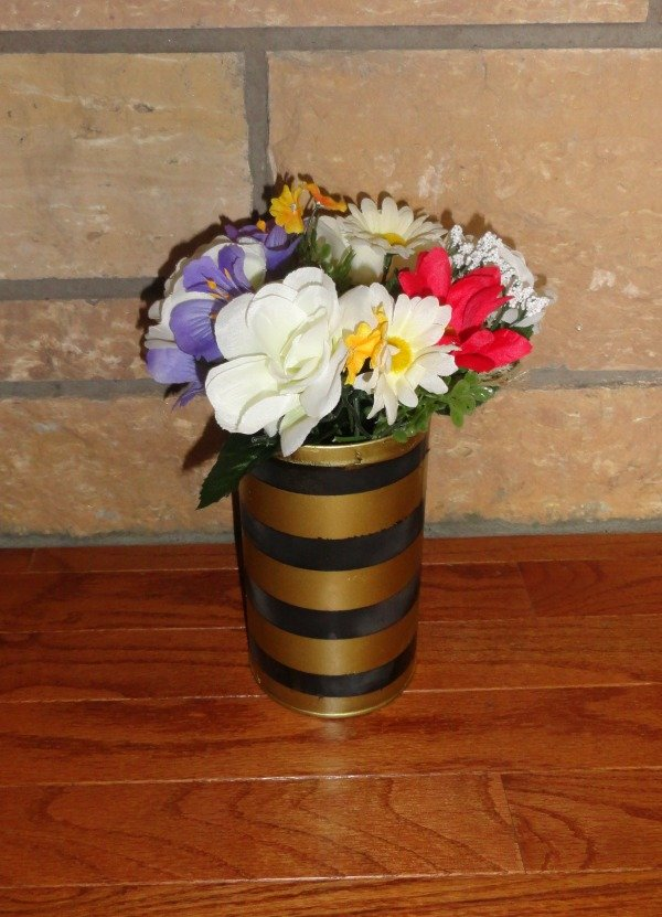 DIY striped pencil holder with flowered accents! Visit mostlymorgan.com to see how to create this!